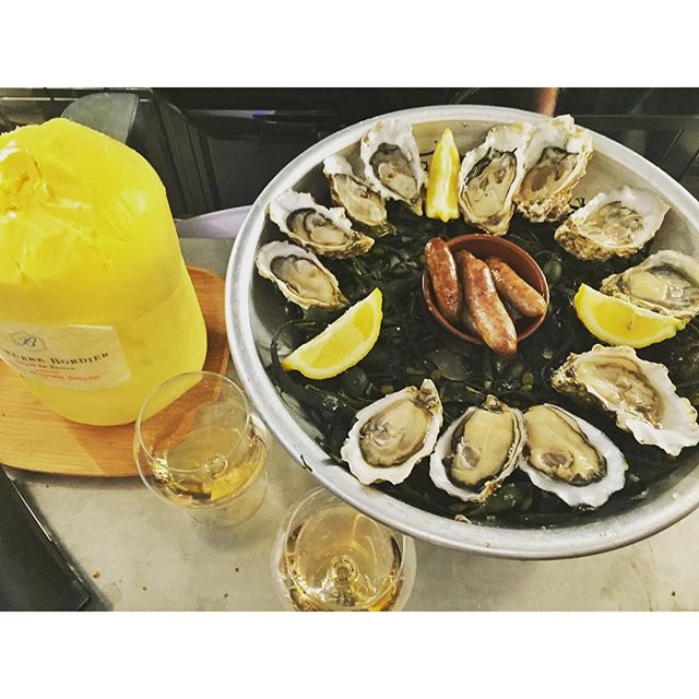 Oysters, Champagne and BUTTER @yves_camdeborde's standing-room only #seafood spot in #PARIS  #oysters #champagne #butter #beurre #foodie #travelgram #yum